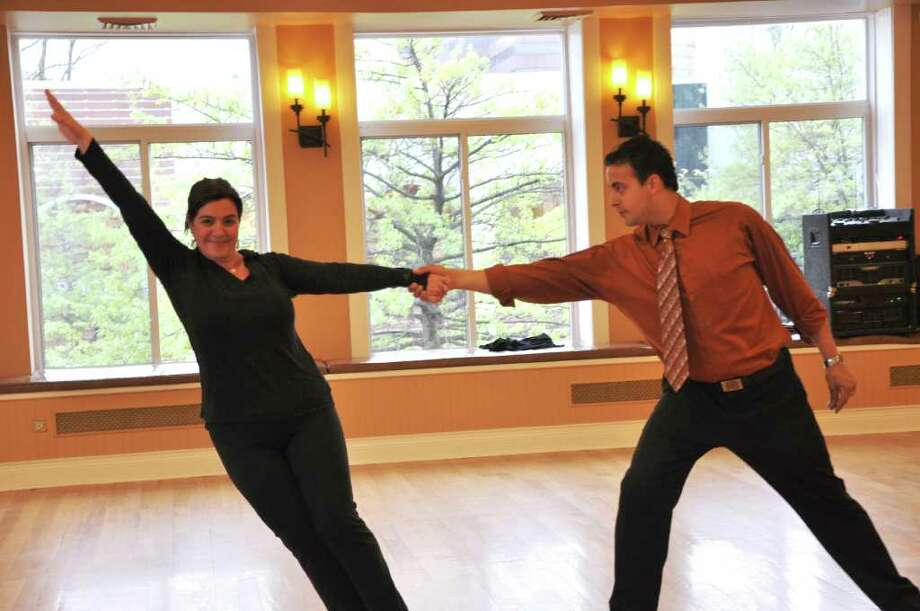 "Tracie Wilson, vice president for programmiing and development for NBC Universal in Stamford, rehearses her dance moves with partner Michael Powers for Saturday's ""Dancing with the Stars, Stamford"" event at the Palace Theatre. Photo: Contributed Photo / Stamford Advocate Contributed"
