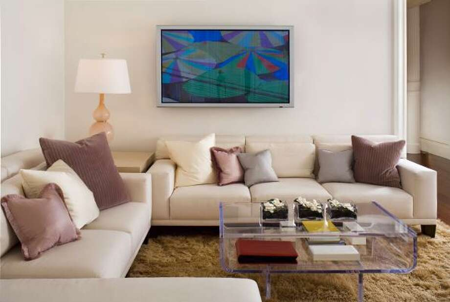 A living room of a Soho loft designed by Coffinier Ku Design uses Lucite pieces. Etienne Coffinier, an architect and furniture designer who grew up in Algeria, Holland and Dubai, works solely in clear Lucite. Photo: Bruce  Buck, Associated Press