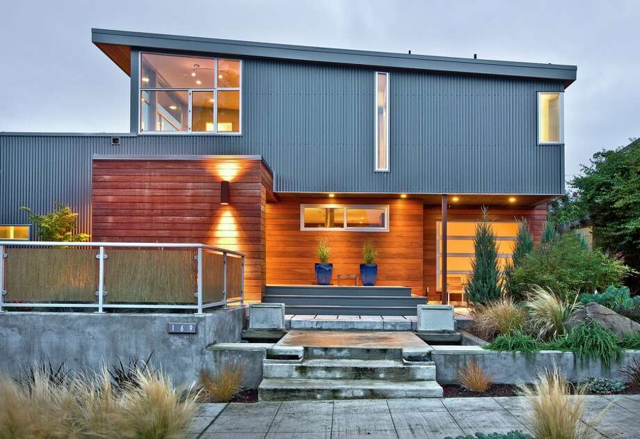 This modern house, at 169 Lynn St., in Queen Anne, is listed for $1.75 million. The 3,450-square-foot house includes five bedrooms, 3.25 baths, a 'floating' staircase, solar heating, 14 solar-power panels, roof deck, built-in saltwater aquarium, theater with hideaway screen, bamboo floors, 50,000 hand-set mosaic tiles, no-paint siding, low-fume materials, low-maintenance landscaping and radiant heat and sits on a 4,000-square foot lot. (Listing: http://www.patriciawallace.com/Seattle_WA_listings/3F78E75F-0555-E6D7-A7A7E91AFF614472.shtml) Photo: Patricia Wallace/Coldwell Banker Bain
