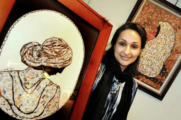 "Ruxana Saifi of Niskayuna with her artwork ""Rough Times,"" left, and ""Summer of Questions,"" both mixed media pieces using address labels and ink, on Wednesday, May 11, 2011, in Albany, N.Y. Saifi attends Al-Fatemah Islamic Center in Colonie. (Cindy Schultz / Times Union) Photo: Cindy Schultz"