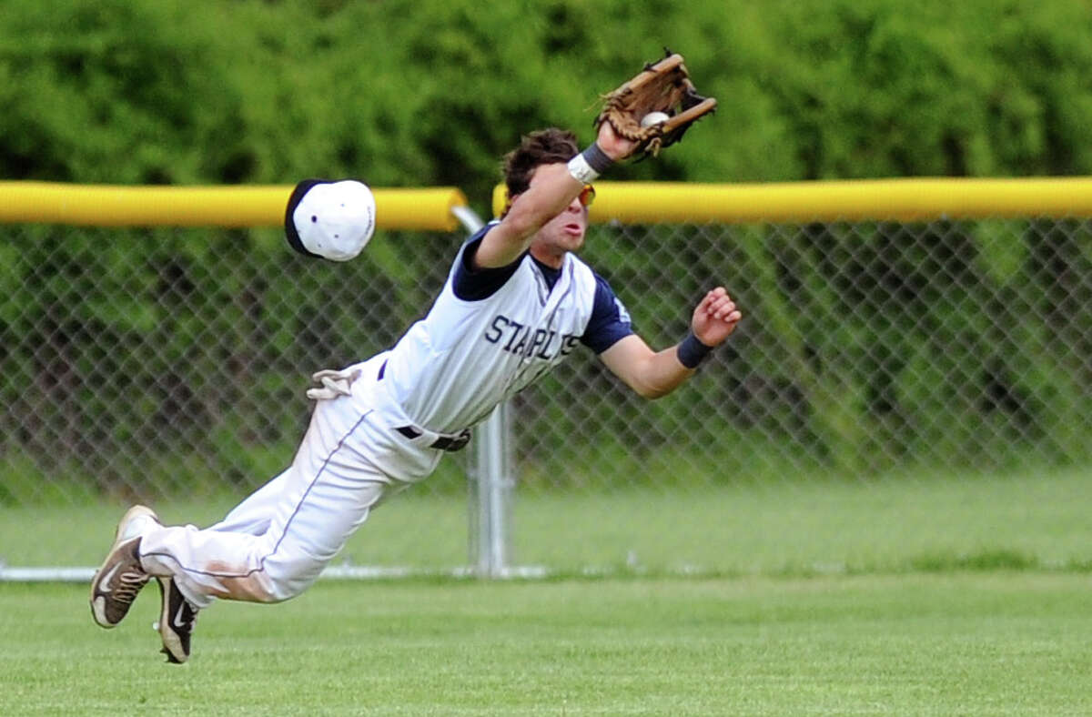 Staples' Ben Lipper makes a diving catch in center field as his hat flies off his head during Friday's game against St. Joseph High School at Staples High School on May 13, 2011.