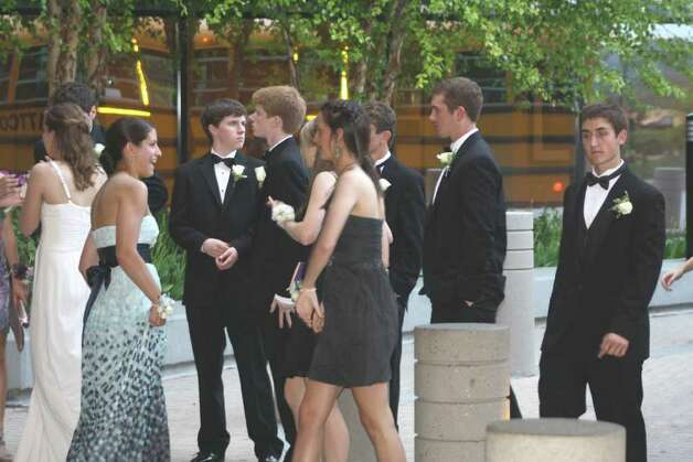 Happy prom-goers waited outside for their friends to arrive. Photo: Contributed Photo / Darien News