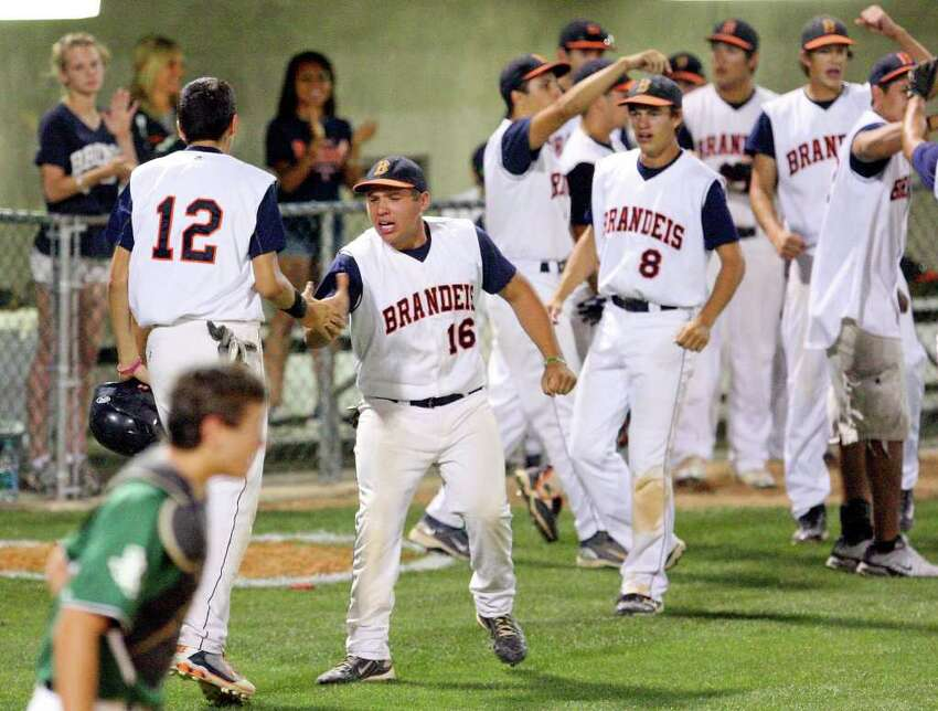 Brandeis' Geno Encina (left) celebrates with teammate Brandeis' Dalton Hatch after scoring against Reagan during the sixth inning Friday May 13, 2011 at Northside Field. Brandeis won 4-1. EDWARD A. ORNELAS/eaornelas@express-news.net