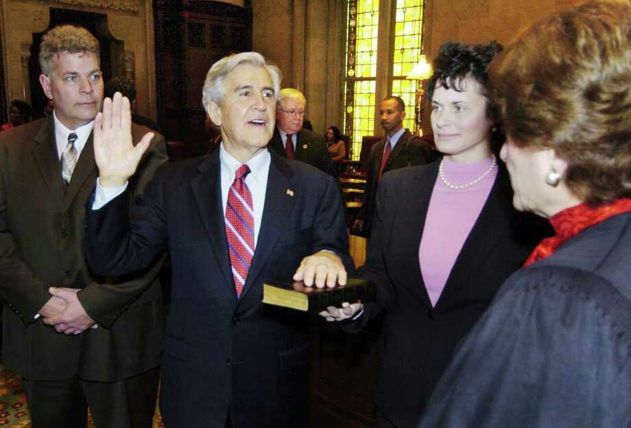 Former Senate Majority Leader Joseph Bruno is sworn in by then Chief Judge Judith Kaye, right, as his daughter, Susan Bruno, holds a bible and his son looks on (far left). (Skip Dickstein / Times Union) Photo: SKIP DICKSTEIN / ALBANY TIMES UNION