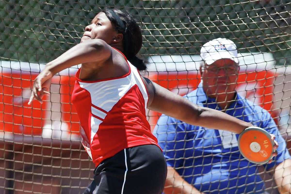 New Braunfels Canyon's Chamaya Turner winds up for a throw in the 4A girls' discus during the State track & field championships at Mike Myers Stadium on May 13, 2011. Turner took home gold with a throw of 162' 08'', nearly 15 feet further than the second place finisher. MARVIN PFEIFFER/mpfeiffer@express-news.net