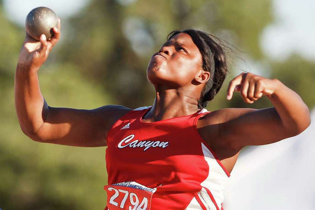 New Braunfels Canyon's Chamaya Turner throws the shot put in the 4A girls' competition during the State track & field championships at Mike Myers Stadium on May 13, 2011. Turner finished second in the event with a throw of 42-3 3/4. MARVIN PFEIFFER/mpfeiffer@express-news.net