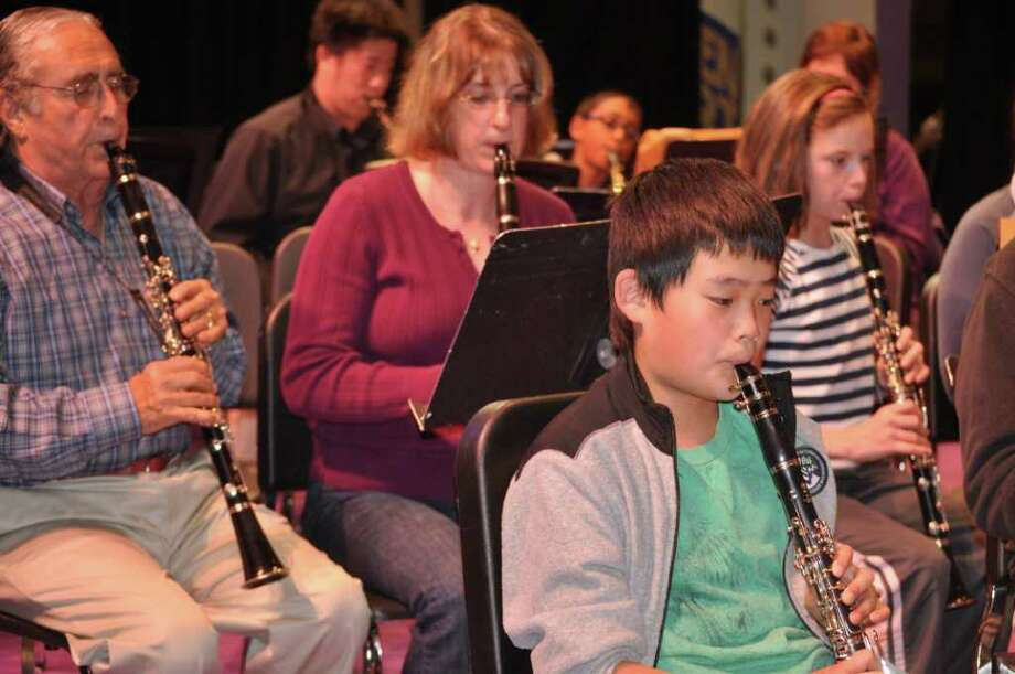 Back Row, left to right: Clarinetists John Weiss, WCB, Westport, Jaclyn Licek, WCB, Norwalk, Pippa Gosden, the Middlebrook School, Wilton  Front Row: Clarinetist Cian Greene, Weston Middle School Back Row, left to right: Clarinetists John Weiss, WCB, Westport, Jaclyn Licek, WCB, Norwalk, Pippa Gosden, the Middlebrook School, Wilton  Front Row: Clarinetist Cian Greene, Weston Middle School Back Row, left to right: Clarinetists John Weiss, WCB, Westport, Jaclyn Licek, WCB, Norwalk, Pippa Gosden, the Middlebrook School, Wilton  Front Row: Clarinetist Cian Greene, Weston Middle School   Back Row, left to right: Clarinetists John Weiss, WCB, Westport, Jaclyn Licek, WCB, Norwalk, Pippa Gosden, the Middlebrook School, Wilton  Front Row: Clarinetist Cian Greene, Weston Middle School  Back Row, left to right: Clarinetists John Weiss, WCB, Westport, Jaclyn Licek, WCB, Norwalk, Pippa Gosden, the Middlebrook School, Wilton  Front Row: Clarinetist Cian Greene, Weston Middle School Back Row, left to right: Clarinetists John Weiss, WCB, Westport, Jaclyn Licek, WCB, Norwalk, Pippa Gosden, the Middlebrook School, Wilton  Front Row: Clarinetist Cian Greene, Weston Middle School   Students perform with members of the Westport Community Band. Pictured are, back row, band clarinetists John Weiss of Westport and Jaclyn Licek of Norwalk; Pippa Gosden, a student from the Middlebrook School in Wilton; and front Row, clarinetist Cian Greene from Weston Middle School.  Back Row, left to right: Clarinetists John Weiss, WCB, Westport, Jaclyn Licek, WCB, Norwalk, Pippa Gosden, the Middlebrook School, Wilton  Front Row: Clarinetist Cian Greene, Weston Middle School Photo: Contributed Photo