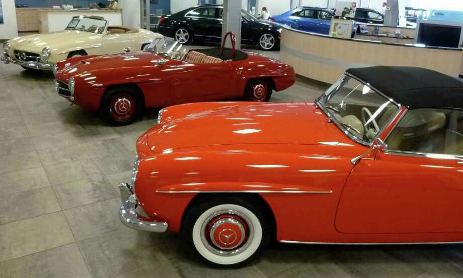 Classic Mercedes-Benz models mix with the German car makers' newer offerings in a special display at Mercedes-Benz of Fairfield. Vintage autos here include a 1961 190 SL Coupe, 1955 190 SLR Roadster and a 1962 190 SL Coupe. Photo: Contributed Photo/Mike Lauterborn / Fairfield Citizen contributed