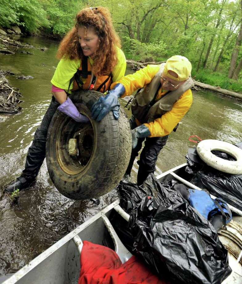 Susan Tomanio, of Bethel, and Ed Foss, of Bridgewater, clean up the Still River in Brookfield during the Seventh Annual Still River Waterway and Greenway Cleanup, Saturday, May 14, 2011. Photo: Michael Duffy / The News-Times