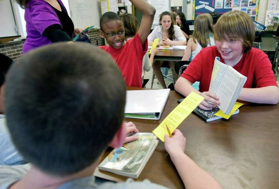 Seventh graders at Turn of River Middle School select their books and begin their first day of their class book club in Stamford, Conn. on Tuesday April 26, 2011. Photo: Kathleen O'Rourke / Stamford Advocate