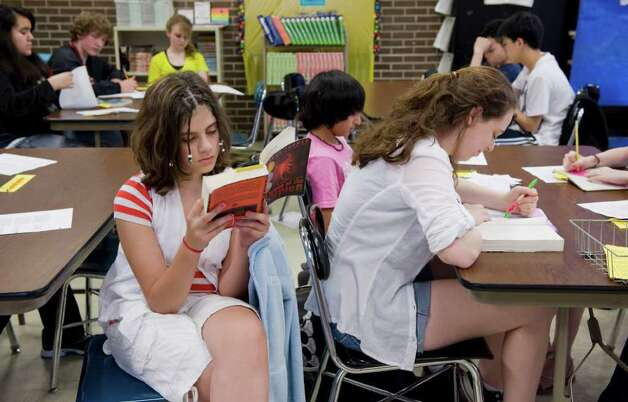 Seventh graders Lindsay Alter, 12, and Emily Yamron, 13, begin reading their book selections on the first day of their class book club at Turn of River Middle School in Stamford, Conn. on Tuesday April 26, 2011. Photo: Kathleen O'Rourke / Stamford Advocate
