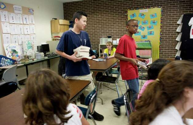 Seventh graders at Turn of River Middle School make their book selections and begin the first day of the class book club in Stamford, Conn. on Tuesday April 26, 2011. Photo: Kathleen O'Rourke / Stamford Advocate