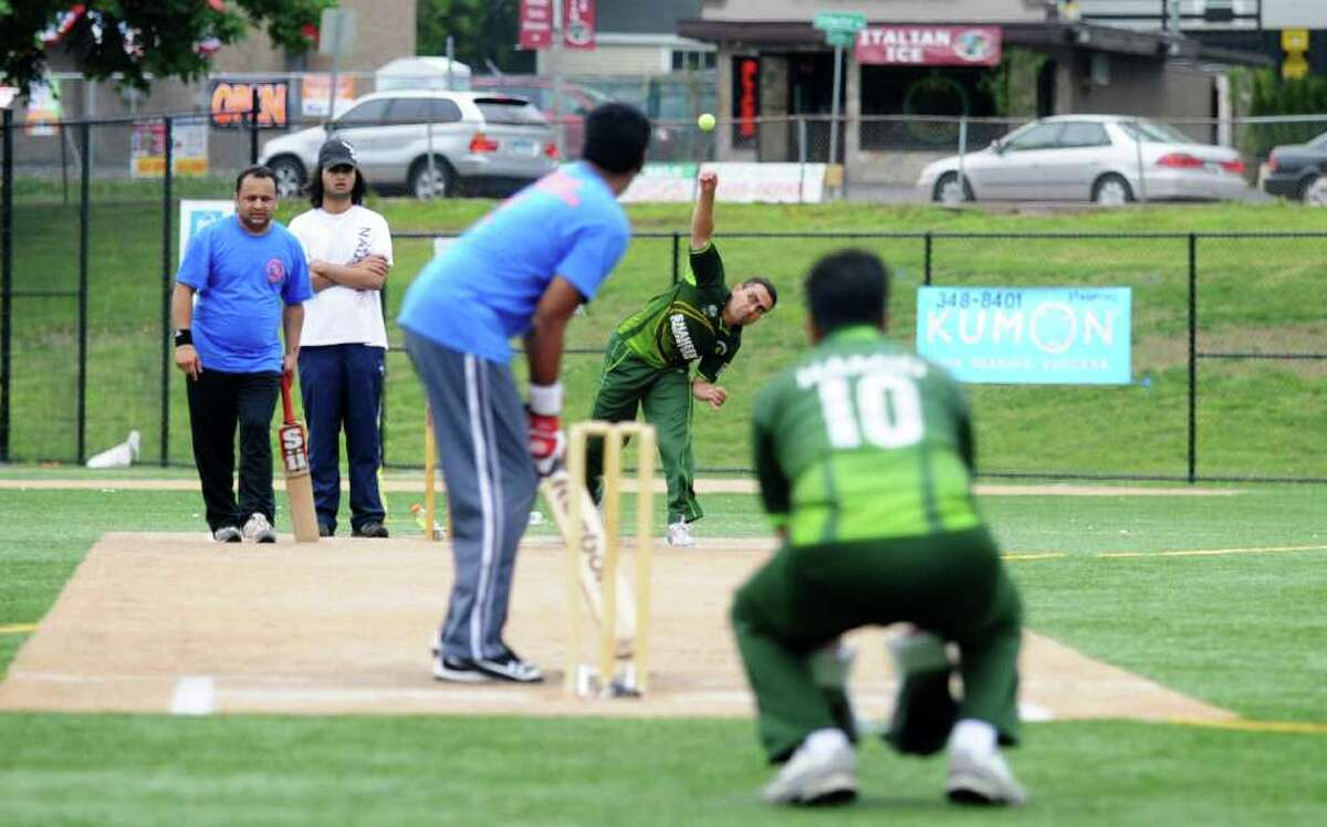 The Shaheen Cricket Club pitches to the Stamford Cricket Club Fighters as they play in the Stamford Cricket Club's First Annual Cricket Cup