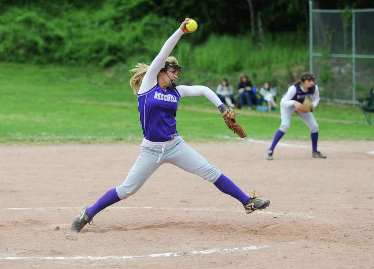 Westhill High School's pitcher Allison Macari delivers to the plate against Staples High School in softball action in Stamford, Conn. on Saturday May 14, 2011.