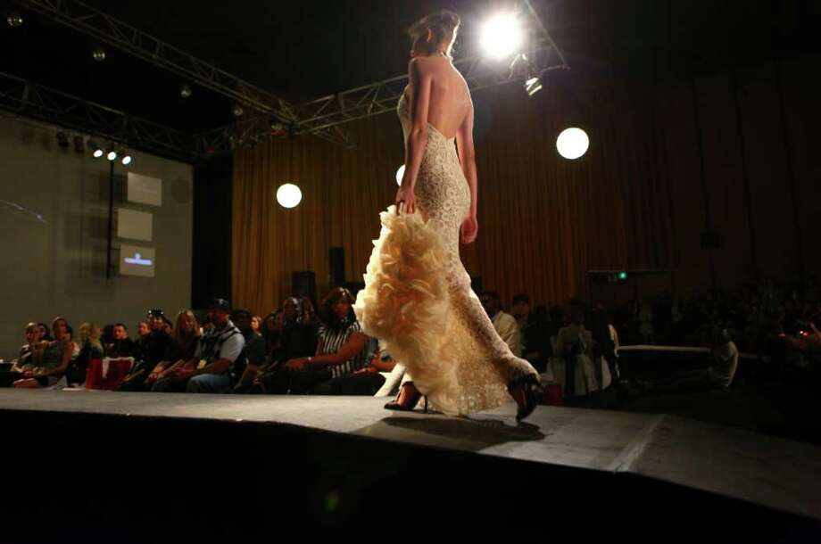 A model walks the runway during Seattle Fashion Week's grand finale show at the King Cat Theater on Friday, May 13, 2011. Photo: JOSHUA TRUJILLO / SEATTLEPI.COM