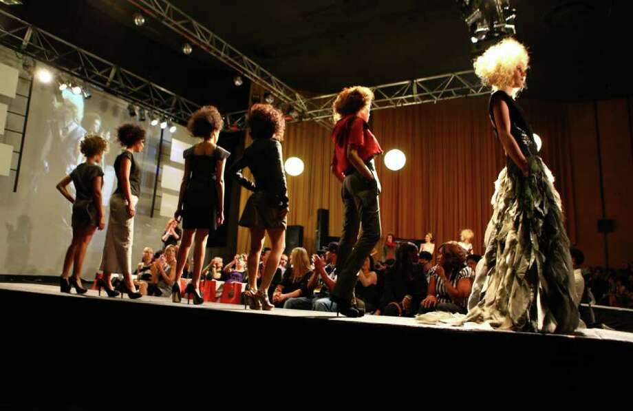 Models walk the runway during Seattle Fashion Week's grand finale show at the King Cat Theater on Friday, May 13, 2011. Photo: JOSHUA TRUJILLO / SEATTLEPI.COM