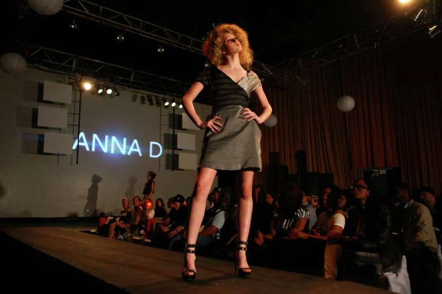 A model walks the runway during Seattle Fashion Week's grand finale show at the King Cat Theater on