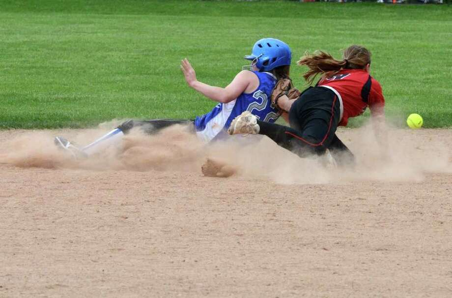 Fairfield Warde's Stacey DiLeo goes after an errant throw as Fairfield Ludlowe's Emily Nelson slides into second base during the softball game at Warde on Friday, May 13, 2011. Photo: Amy Mortensen / Connecticut Post Freelance