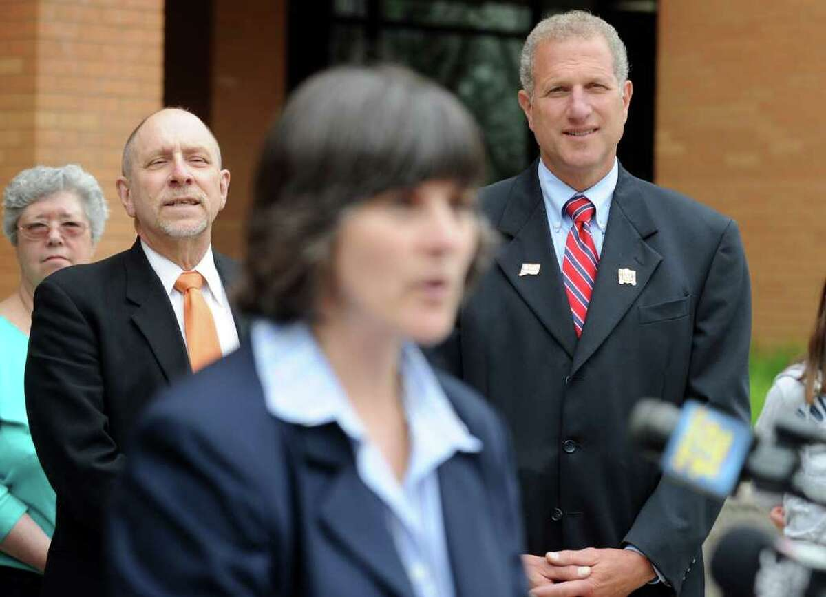 School Superintendent Freeman Burr, left, and Mayor Mark Lauretti listen as Shelton High School Headmaster Dr. Beth A. Smith announces James Tate will be allowed to go to the Shelton High School prom after all during a press conference Saturday, May 14, 2011. The senior was banned from the prom for posting a message May 6 on the school building made with cut-out letters asking friend Sonali Rodrigues to be his date.