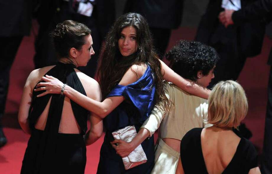 "Actress Emmanuelle Bercot, director Maiwenn Le Besco and actress Naidra Ayadi attend the ""Polisse"" premiere at the Palais des Festivals during the 64th Cannes Film Festival on May 13, 2011 in Cannes, France. Photo: Francois Durand, Getty Images / 2011 Getty Images"