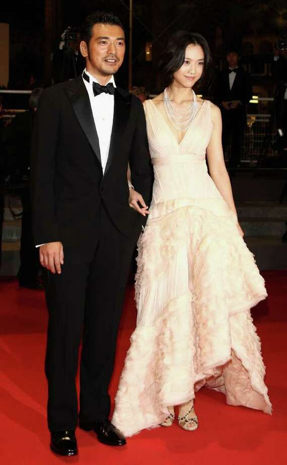 "Actor Takeshi Kaneshiro (L) and actress Tang Wei attend the ""Wu Xia""  premiere at the Palais des Festivals during the 64th Cannes Film Festival on May 13, 2011 in Cannes, France. Photo: Andreas Rentz, Getty Images / 2011 Getty Images"