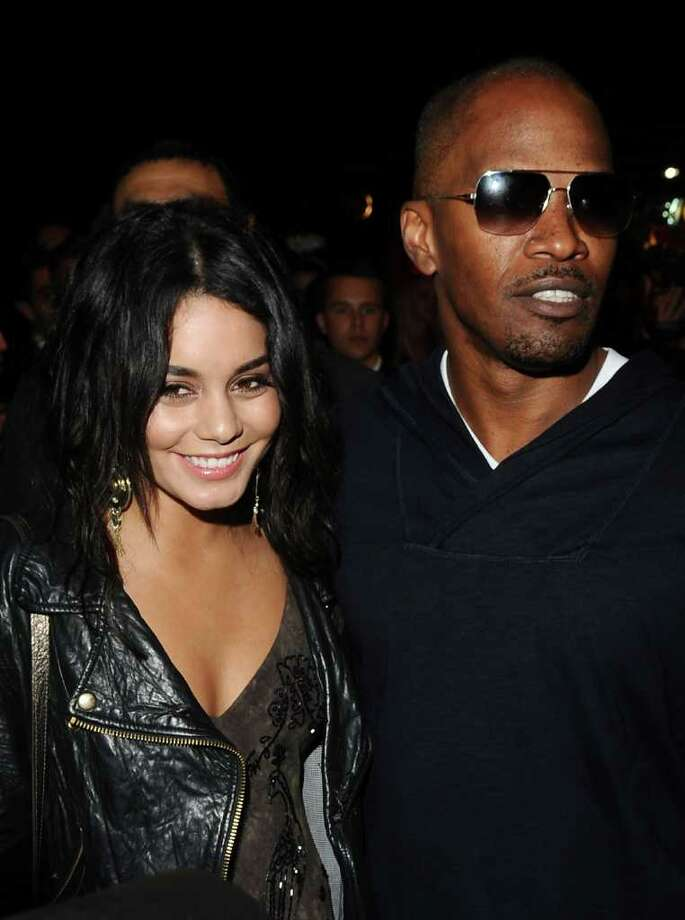 Actress Vanessa Hudgens (L) and actor Jamie Foxx attend the (BELVEDERE) RED party in Cannes to celebrate the European launch of (BELVEDERE) RED featuring a performance by Duran Duran held at the VIP Room Famous Club on May 13, 2011 in Cannes, France. Photo: Ian Gavan, Getty Images For Belvedere / 2011 Getty Images