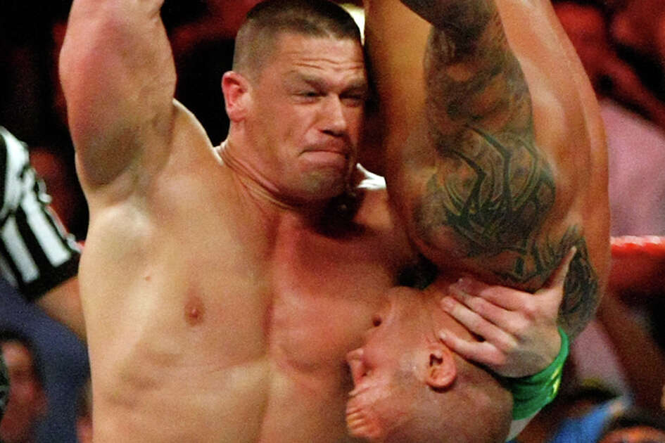 "John Cena, shown at ""Monday Night Raw"" event in Las Vegas in 2009, should be on hand at the AT&T Center Monday."