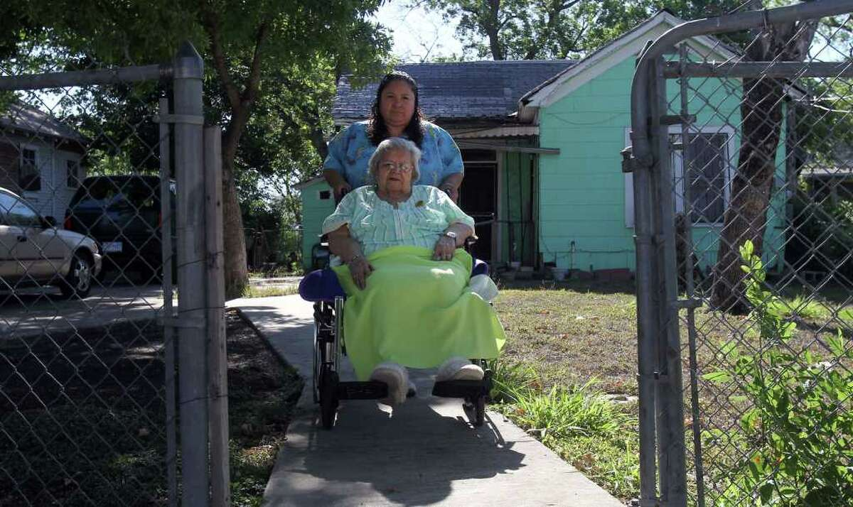 Julia Gomez, 90 (in wheelchair), leaves her West Side home on Smith Street to vote at Lanier High School on Election Day, Saturday, May 14, 2011. Gomez has health issues, but considers it her civic duty to get to the polls and vote regardless. Pushing Gomez is her caretaker Dolores Olivares.