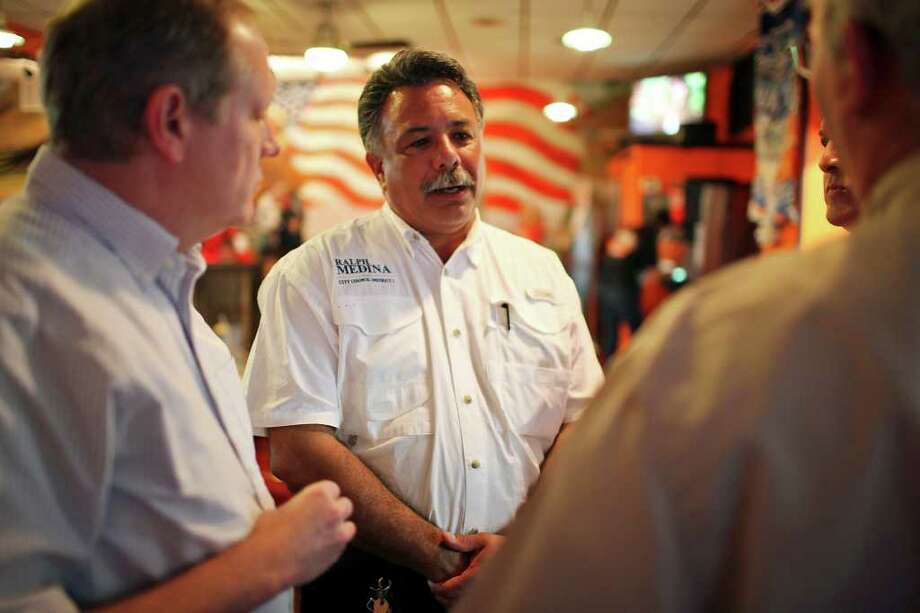 Ralph Medina (center), who is running for San Antonio City Council in District 1, talks with supporters at Frank's Hog Stand on Saturday, May 14, 2011, while waiting for election results. Photo: Edward A. Ornelas/Express-News / SAN ANTONIO EXPRESS-NEWS (NFS)