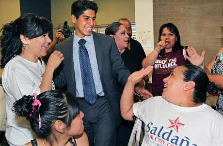 In this May 2011 photo, Rey Saldaña gets high-fives from extended family members as he thanks supporters after winning the District 4 council seas. At 24, he become one of San Antonio's youngest-ever council members. Photo: Tom Reel/Express-News / © 2011 San Antonio Express-News