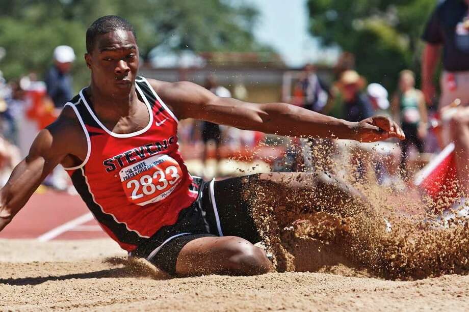 "Stevens' Mykkele Thompson lands in the pit after jumping 24' 00 1/2"" to take third place in the 5A boys' long jump during the State Track & Field championships at Mike Myers Stadium on May 14, 2011.  MARVIN PFEIFFER/mpfeiffer@express-news.net Photo: MARVIN PFEIFFER, Express-News / Express-News 2011"