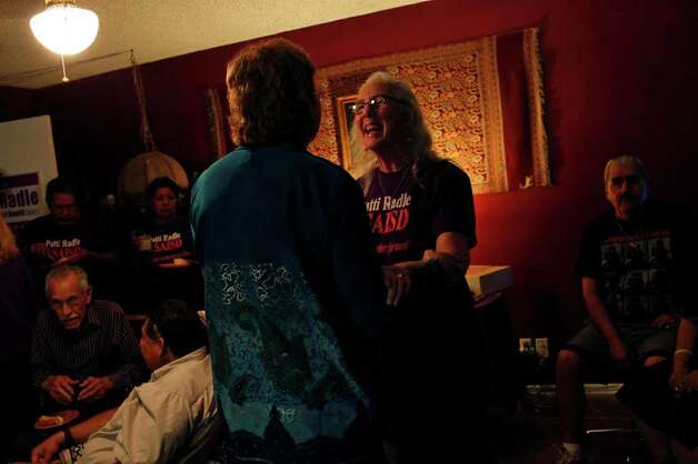 Patti Radle is congratulated by Karen Seal (left) as they celebrate election results for Radle's successful run for the SAISD Board of Trustees at her home on Saturday, May 14, 2011. Photo: Lisa Krantz/Express-News / SAN ANTONIO EXPRESS-NEWS