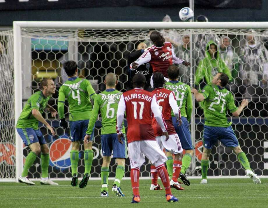 Portland Timbers' Mamadou Danso, upper center, leaps to head in a goal past Seattle Sounders goalkeeper Kasey Keller, upper center left, in the second half of a MLS soccer match, Saturday, May 14, 2011, in Seattle.  Photo: AP