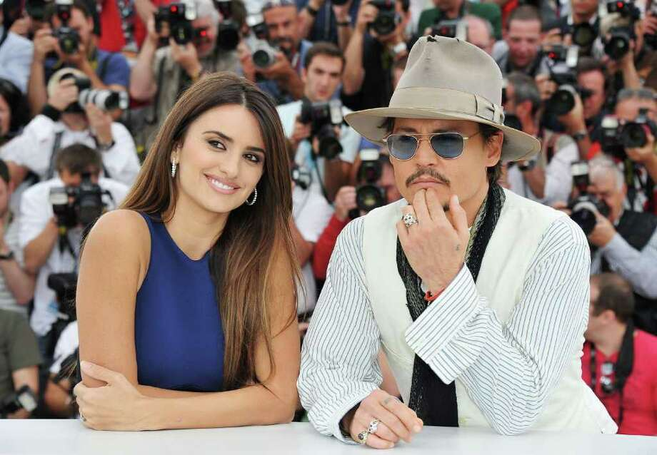 "Actor Johnny Depp (R) and actress Penelope Cruz attend the ""Pirates of the Caribbean: On Stranger Tides"" photocall at the Palais des Festivals during the 64th Cannes Film Festival on May 14, 2011 in Cannes, France. Photo: Pascal Le Segretain, Getty Images / 2011 Getty Images"