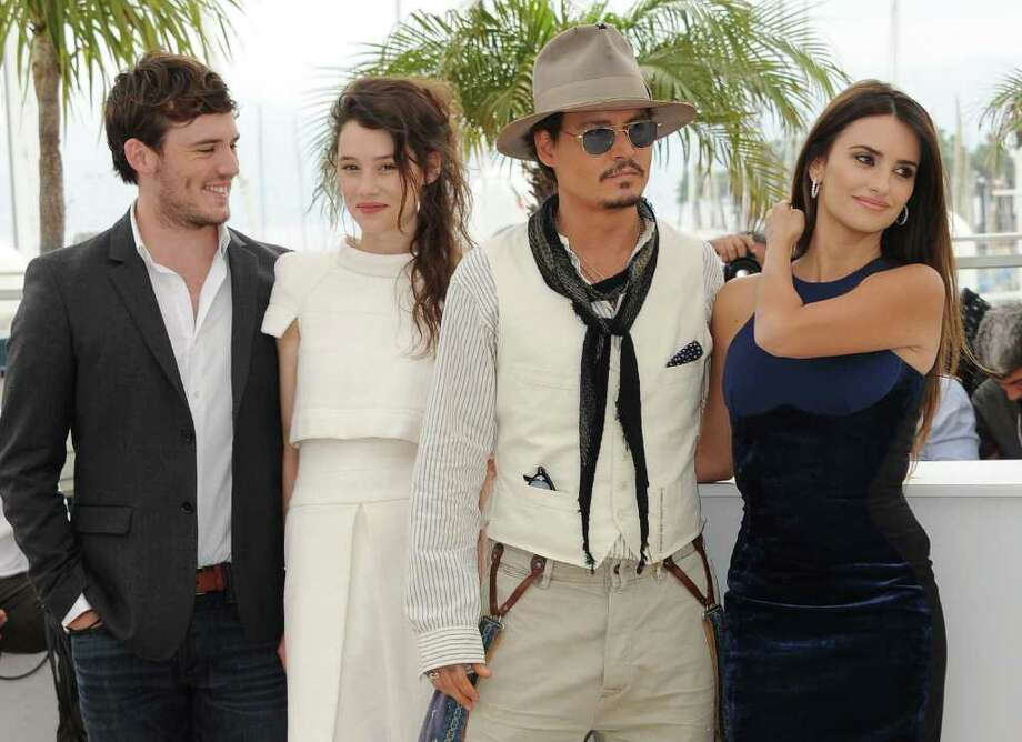 "(L-R) Actors Sam Caflin, Astrid Berges-Frisbey, Johnny Depp, and Penelope Cruz attend the ""Pirates of the Caribbean: On Stranger Tides"" photocall at the Palais des Festivals during the 64th Cannes Film Festival on May 14, 2011 in Cannes, France. Photo: Francois Durand, Getty Images / 2011 Getty Images"