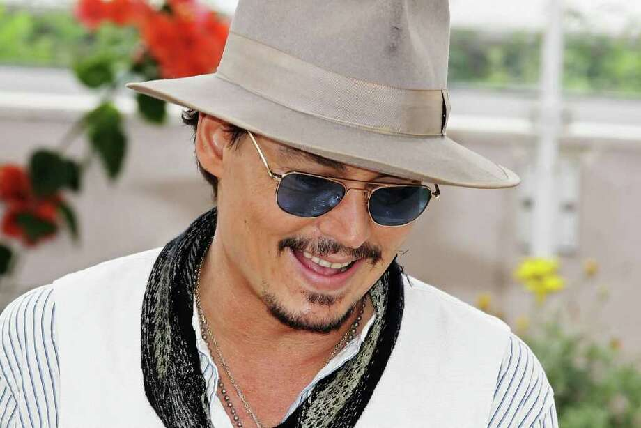 """Actor Johnny Depp  attends the """"Pirates of the Caribbean: On Stranger Tides"""" photocall at the Palais des Festivals during the 64th Cannes Film Festival on May 14, 2011 in Cannes, France. Photo: Andreas Rentz, Getty Images / 2011 Getty Images"""