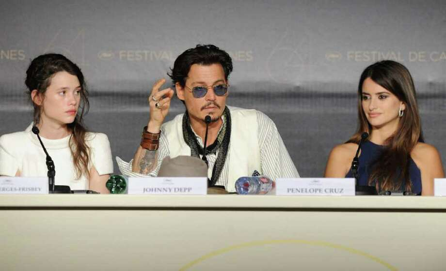 "(L-R) Actors Astrid Berges-Frisbey, Johnny Depp and Penelope Cruzattends the ""Pirates of the Caribbean: On Stranger Tides"" press conference at the Palais des Festivals during the 64th Cannes Film Festiva lon May 14, 2011 in Cannes, France. Photo: Francois Durand, Getty Images / 2011 Getty Images"