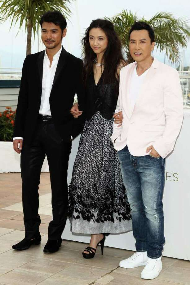 "Takeshi Kaneshiro, Tang Wei, and Donnie Yen attends the ""Wu Xia"" Photocall at the Palais des Festivals during the 64th Cannes Film Festival on May 14, 2011 in Cannes, France. Photo: Andreas Rentz, Getty Images / 2011 Getty Images"