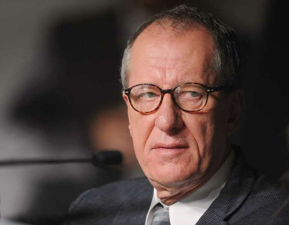 """Actor Geoffrey Rush  attends the """"Pirates of the Caribbean: On Stranger Tides"""" press conference at the Palais des Festivals during the 64th Cannes Film Festiva lon May 14, 2011 in Cannes, France. Photo: Francois Durand, Getty Images / 2011 Getty Images"""