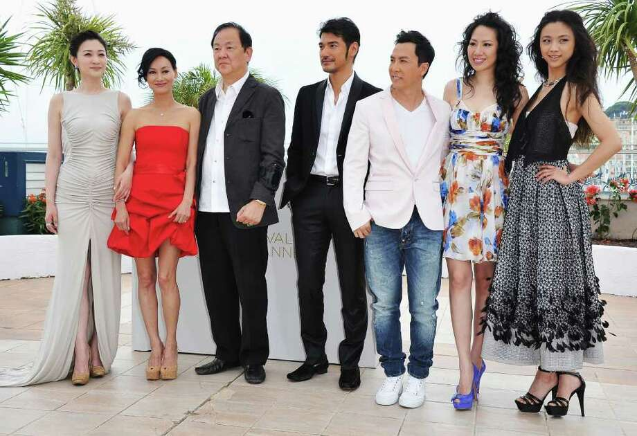 "(L-R) Li Xiao Ran, Kara Hui, Jimmy Wang Yu, Takeshi Kaneshiro, Donnie Yen, Cecilia Cissy Wang, and Tang Wei attend the ""Wu Xia"" Photocall at the Palais des Festivals during the 64th Cannes Film Festival on May 14, 2011 in Cannes, France. Photo: Pascal Le Segretain, Getty Images / 2011 Getty Images"