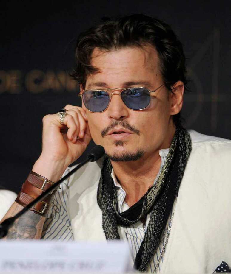 "Actor Johnny Depp attends the ""Pirates of the Caribbean: On Stranger Tides"" press conference at the Palais des Festivals during the 64th Cannes Film Festiva lon May 14, 2011 in Cannes, France. Photo: Francois Durand, Getty Images / 2011 Getty Images"