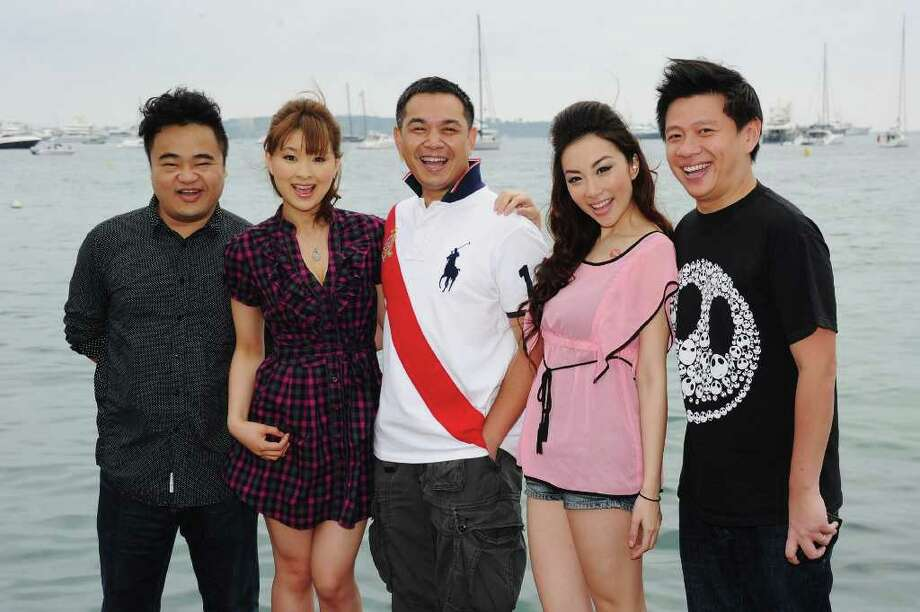 "(Left to Right) Writer Mark Wu, actress Yukiku Suou, director Christopher Sun , actress Vonnie Lui and producer Stephen Shiu Jr attend the ""3D Sex And Zen: Extreme Ecstacy"" photocall at the Majestic Beach Pier during the 64th Cannes Film Festival on May 14, 2011 in Cannes, France. Photo: Michael Buckner, Getty Images / 2011 Getty Images"