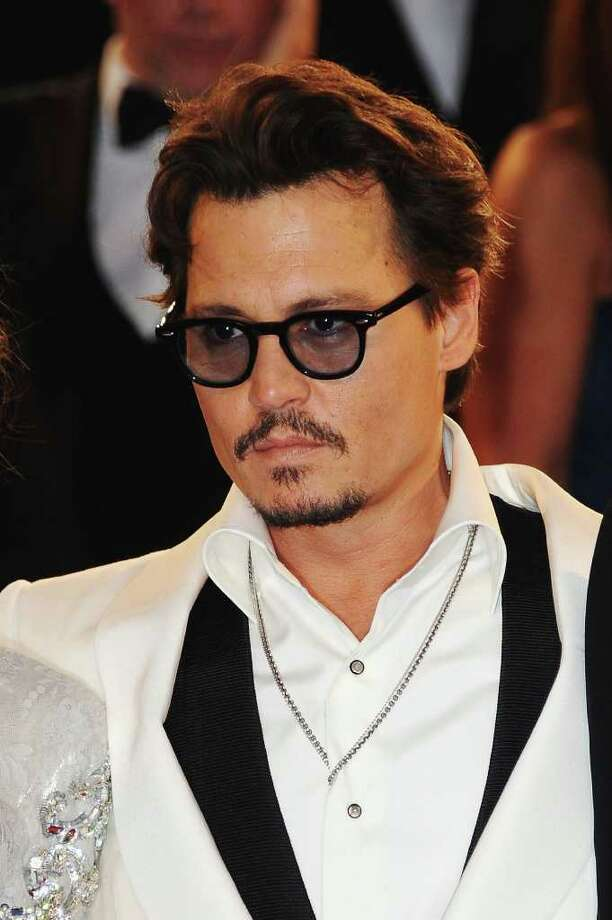 "Actor Johnny Depp departs the ""Pirates of the Caribbean: On Stranger Tides"" premiere at the Palais des Festivals during the 64th Cannes Film Festival on May 14, 2011 in Cannes, France. Photo: Francois Durand, Getty Images / 2011 Getty Images"