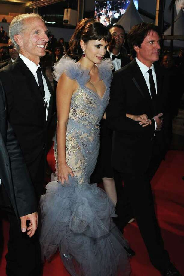 "Actress Penelope Cruz (C) and director Rob Marshall (R) depart the ""Pirates of the Caribbean: On Stranger Tides"" premiere at the Palais des Festivals during the 64th Cannes Film Festival on May 14, 2011 in Cannes, France. Photo: Francois Durand, Getty Images / 2011 Getty Images"
