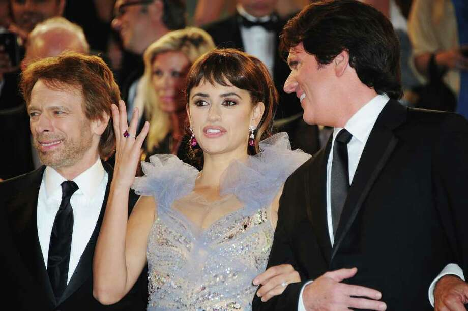 "(L-R)  Producer Jerry Bruckheimer, actress Penelope Cruz,and director Rob Marshall depart the ""Pirates of the Caribbean: On Stranger Tides"" premiere at the Palais des Festivals during the 64th Cannes Film Festival on May 14, 2011 in Cannes, France. Photo: Francois Durand, Getty Images / 2011 Getty Images"