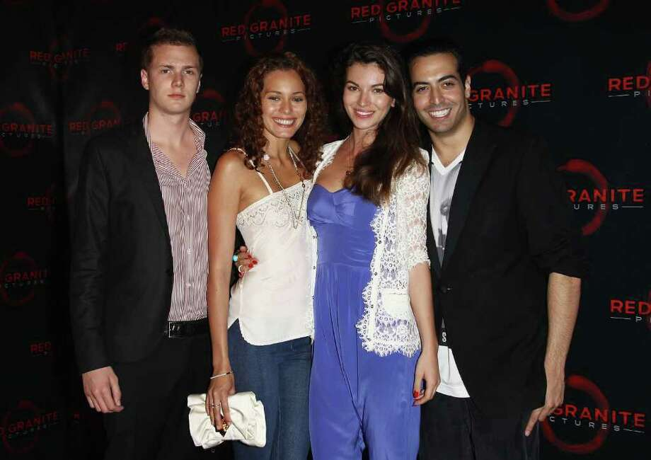 (L-R) Barron Hilton, Dafne Rotllo, Nadya Nepomnyashaya and Mo Al Turki attend the Red Granite Party during the 64th Annual Cannes Film Festival at Carlton Beach on May 14, 2011 in Cannes, France. Photo: Andreas Rentz, Getty Images / 2011 Getty Images
