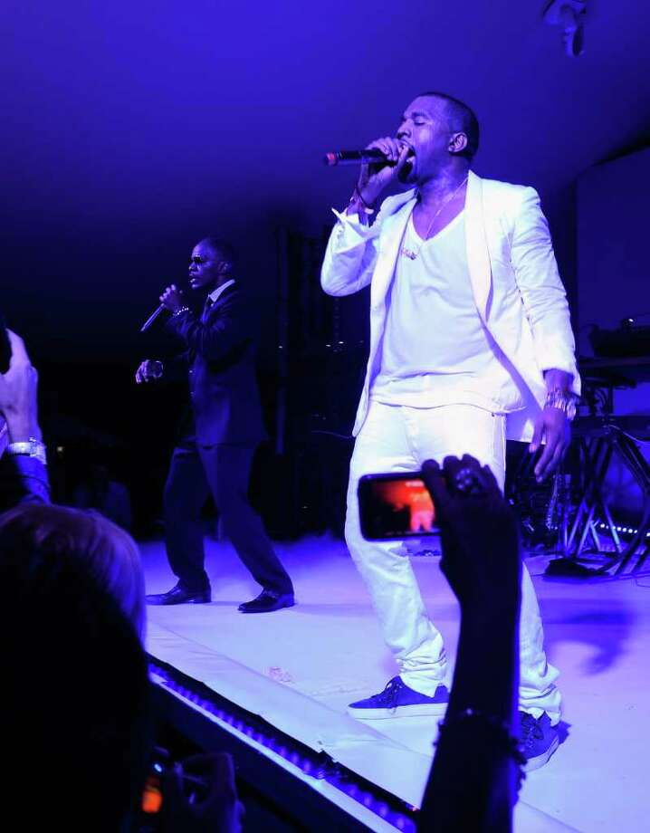 (L-R) Jamie Foxx and Kanye West perform at the Red Granite party at Carlton Beach on May 14, 2011 in Cannes, France. Photo: Andrew H. Walker, Getty Images / 2011 Getty Images