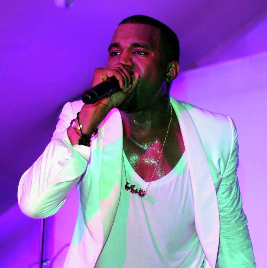 Kanye West performs at the Red Granite party at Carlton Beach on May 14, 2011 in Cannes, France. Photo: Andrew H. Walker, Getty Images / 2011 Getty Images