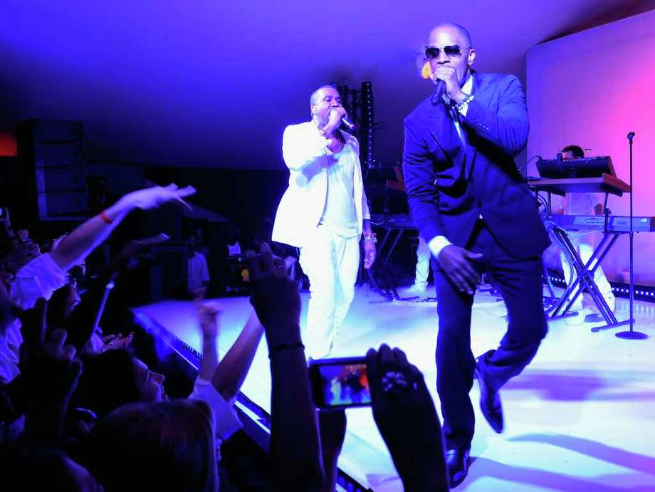 (L-R) Kanye West and Jamie Foxx perform at the Red Granite party at Carlton Beach on May 14, 2011 in Cannes, France. Photo: Andrew H. Walker, Getty Images / 2011 Getty Images