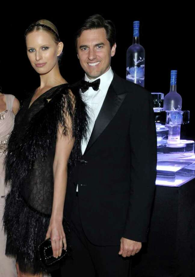 Model Karolina Kurkova (L) and Archie Drury attend the CAA Party with Grey Goose at Soho House Cannes in celebration of the 64th Annual Cannes Film Festival at Villa Eilenroc on May 14, 2011 in Cannes, France. Photo: Michael Buckner, Getty Images For Grey Goose / 2011 Getty Images